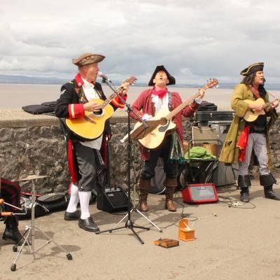 Piratitude Gallery Image. -  Piratitude pirate band busking in Clevedon