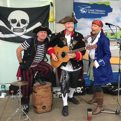 Piratitude Gallery Image. -  GWAAC Charity shop opening band