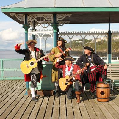 Piratitude Gallery Image. -  Piratitude - band shot gazing out to see on The Pier of the Year 2021
