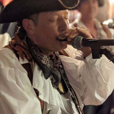 Piratitude Gallery Image. -  Lefty on Harmonica