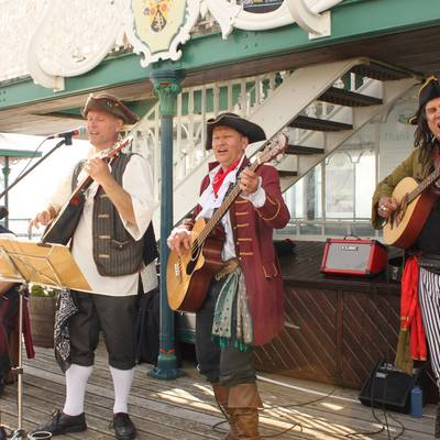 Piratitude Gallery Image. -  Pirate band busking at the end of Clevedon Pier